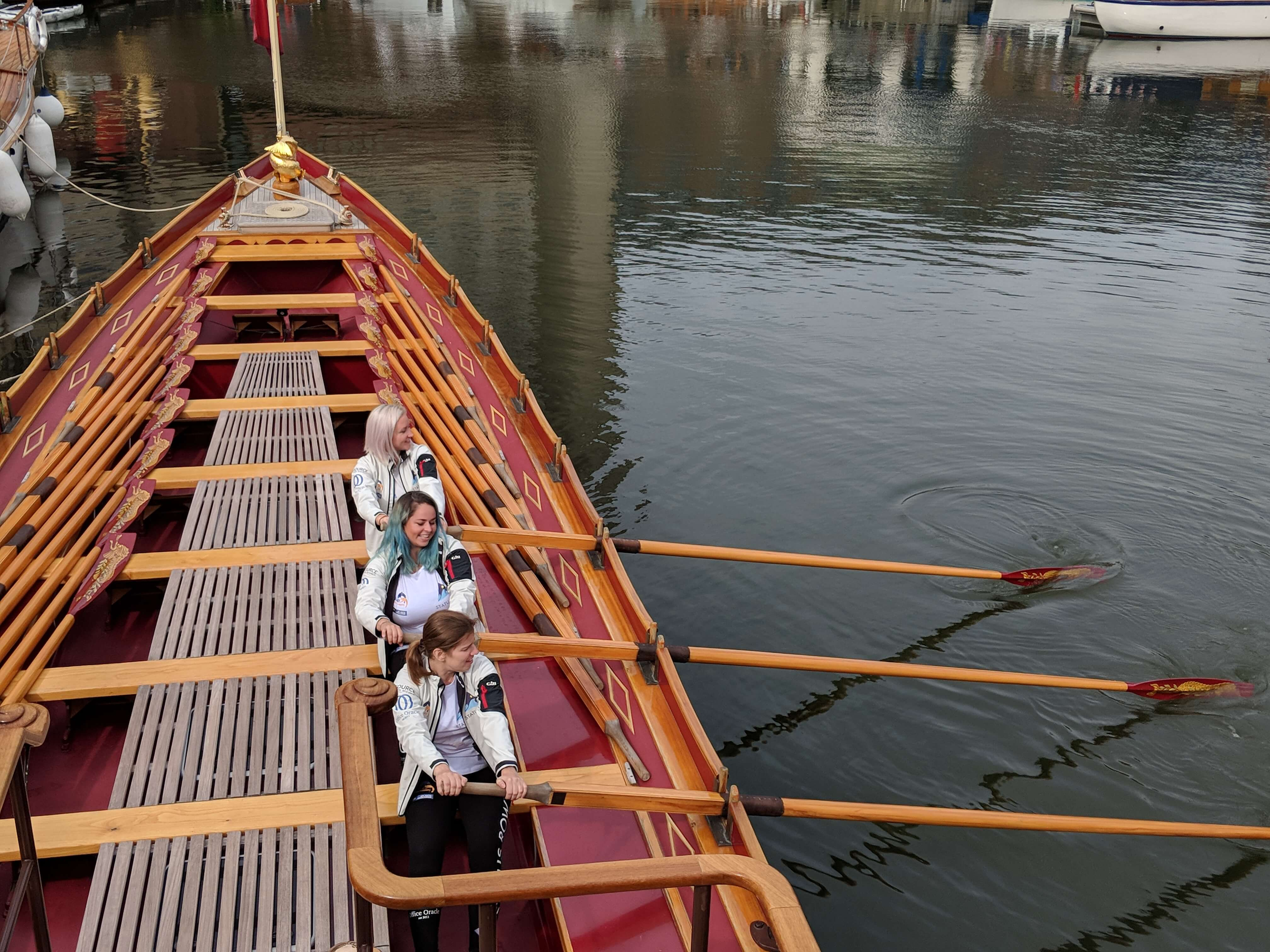 Taking to the oars on Gloriana, the Queen's Rowbarge